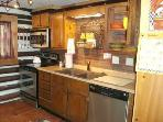 Kitchen with new stainless appliances, counter top & granite sink - equipped with quality cookware