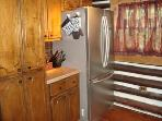 Kitchen with lots of cabinets; upscale refrigerator with French doors & freezer drawer