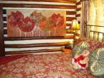 Cheerful Queen Bedroom Suite with Fanciful Jeweled Wall Art on Log & Chink Walls
