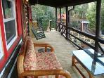 Covered Front Porch sofa & bench swing - a great place to relax!