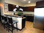 Fully equipped kitchen with breakfast island for 3.