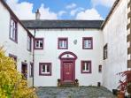 THE MOOT, pet friendly, character holiday cottage, with a garden in Ireby , Ref 11446