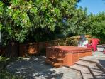 Hot tub area, tree lined and serene.