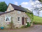 WERN TANGLAS COTTAGE, pet friendly, character holiday cottage, with a garden in Newcastle-On-Clun, Ref 12897
