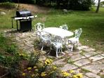 Terrace with Grill and Wrought Iron Table
