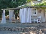Private grapevine wrapped trellis w/ privacy curtains, wonderful place to relax and chat w/ friends