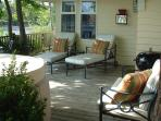 The Main Deck of The Cove Cottage overlooking the Cove and Harbor with 4-Person Hot Tub