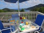 The pool deck is great for breakfast, with views of Coral Bay and the mountains. Charming.