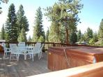 large upstairs deck with hot tub a