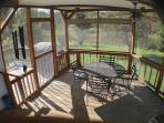 Our attached outdoor 4 sided screened dining area with views to the rear yard and Pleasant Pasture