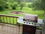 Our new 5 burner gas grill and the locally quarried VT Slate Grand Firepit in the rear yard