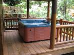 OUTDOOR HOT TUB.  Hot year round, a great way to relax