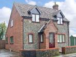 THISTLEDEW, a detached cottage, with three bedrooms, open fire, and courtyard garden, Ref 15502