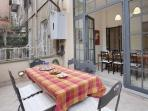 A spacious and comfortable apartment with terrace in the heart of the Monti district.