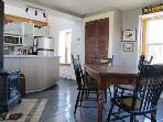 A fully functional kitchen with a charming dining area.