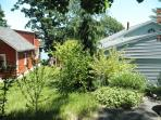 Our nearest neighbor shares back sides of property separated by shrubs and fencing