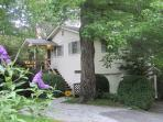 The Guest House is nestled among tall maples, oaks, hemlocks, & rhododendron with parking adjacent.