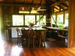 Casa Dos Rio's kitchen has solar refrigerator and a big island, plus view of the water.