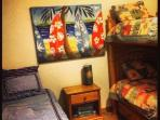 Second bedroom with 1 full bed, 2 twin beds