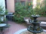 Courtyard with outdoor seating, fountain, and gas-grill for our guests.