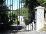 The villa is behind private security gate and includes a long driveway that can fit up to 3 vehicles