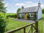 ROSE COTTAGE, near walks and fishing, off road parking, with a garden, in Stranraer, Ref 8201