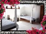 3rd Bedroom Upstairs. 2 twin beds, A/C, 2 extra twins for max sleeping 8 guests including children