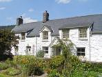 THE FARMHOUSE, Grade II listed pet-friendly cottage with woodburner, garden, close to Betws-y-Coed, Ref 18628