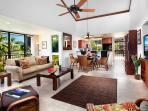 Living / dinning area with view of kitchen and second lanai