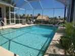 Villa Palmetto - SW Cape Coral 3b/2ba deluxe home with electric heated pool on gulf access canal, HSW Internet, Pool Table, Boat Dock with Tiki Hut