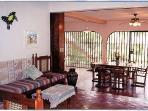 The living room and dining room is an open air screened in room (really cool!), with overhead fans. There is no air...