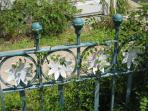 One of Cape May's oldest iron fences frames the front yard.  Home of the daisy garden