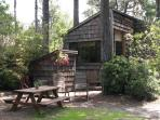 outdoor gas grill and picnic area, wooden chairs and picnic table