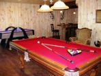 Game Room with pool table, air hockey, wet bar & wide screen TV.