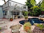 Island Oasis: 2BR Canal Home with Pool and Dock