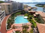 CARIBBEAN PEARL...Porto Cupecoy, top floor with expansive views of the marina, lagoon and ocean