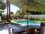 The sun is hot but our umbrellas and 25 palm trees work great!