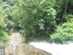 The end of canyoning waterfall tour on top of 50 meters high fall. Wow .
