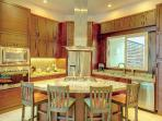 An entertainer's cook's kitchen.  Everything a good cook would enjoy is readily available.