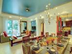 Entertainer's livingroom/diningroom accented by a painted recessed ceiling.