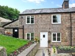 FLAG COTTAGE, all ground floor, character features, side lawned garden, in Cromford, Ref 25467