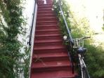 Up the stairs at the back of the property is your rental...
