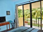 Master bedroom with view of ocean from balcony