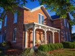 Charming Brick Farmhouse with a Touch of Elegance!