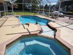 Serenity - Cape Coral 3b/2ba home w/electric heated pool/spa, gulf access canal, HSW Internet, Boat Dock