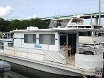 Wisdom Houseboat docked at Gilbert's in Key Largo