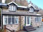 THE COTTAGE, COED Y CELYN, woodburner, character features, pet-friendly, near Betws-y-Coed, Ref. 22767