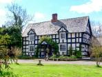 WHITE HOPTON HOUSE, 17th century, detached, over three floors, woodburning stove, parking, garden, in Sarn, Ref 906834