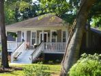Front of home. Fenced for privacy. Nearly ½ acre of land. Porches all around. Large ! 2440 SQ FT!