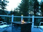 2nd floor deck with outdoor gas fireplace and forest views